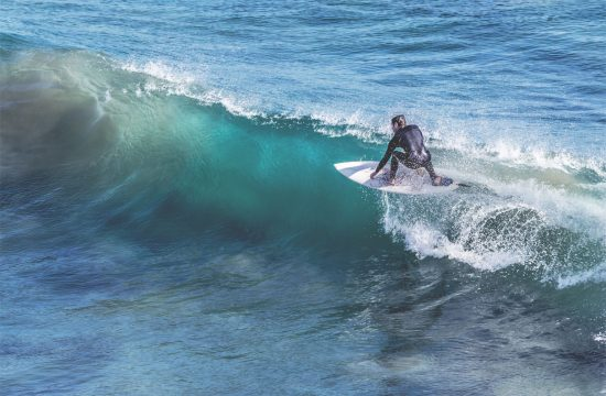Person surfing a wave at diggers beach