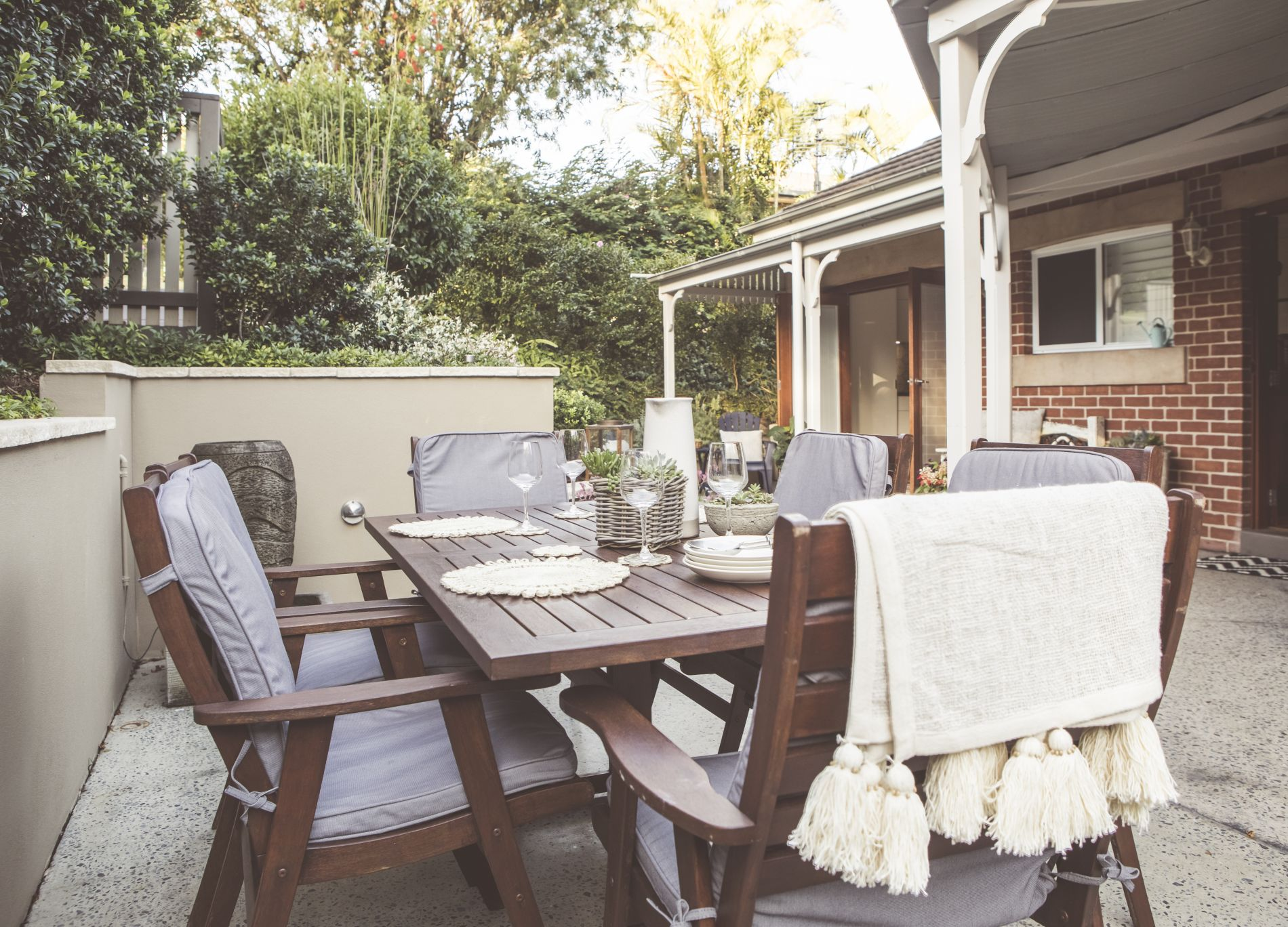 Private courtyard setting for alfresco dining in front of cottage at Diggers Beach Coffs Coast