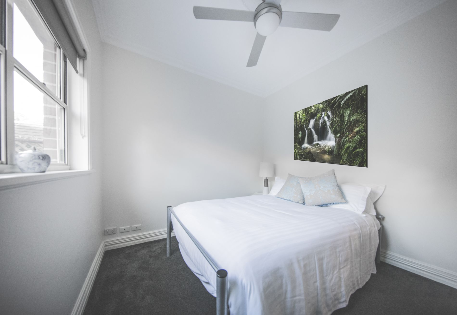 Three bedroom soft light linens and quality furnishings on queen bed at Diggers Beach Cottage
