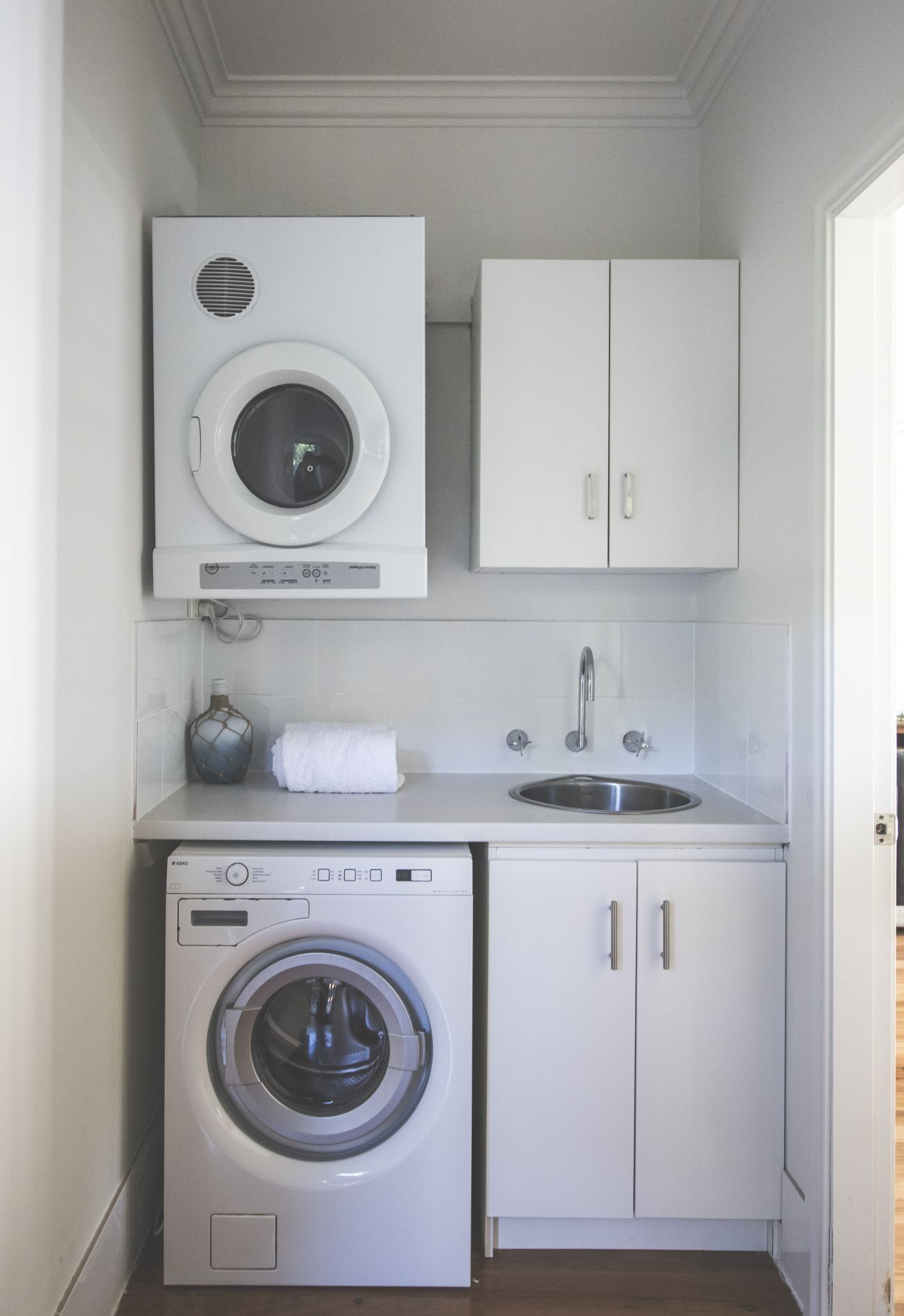New washer and dryer in modern tidy laundry nook