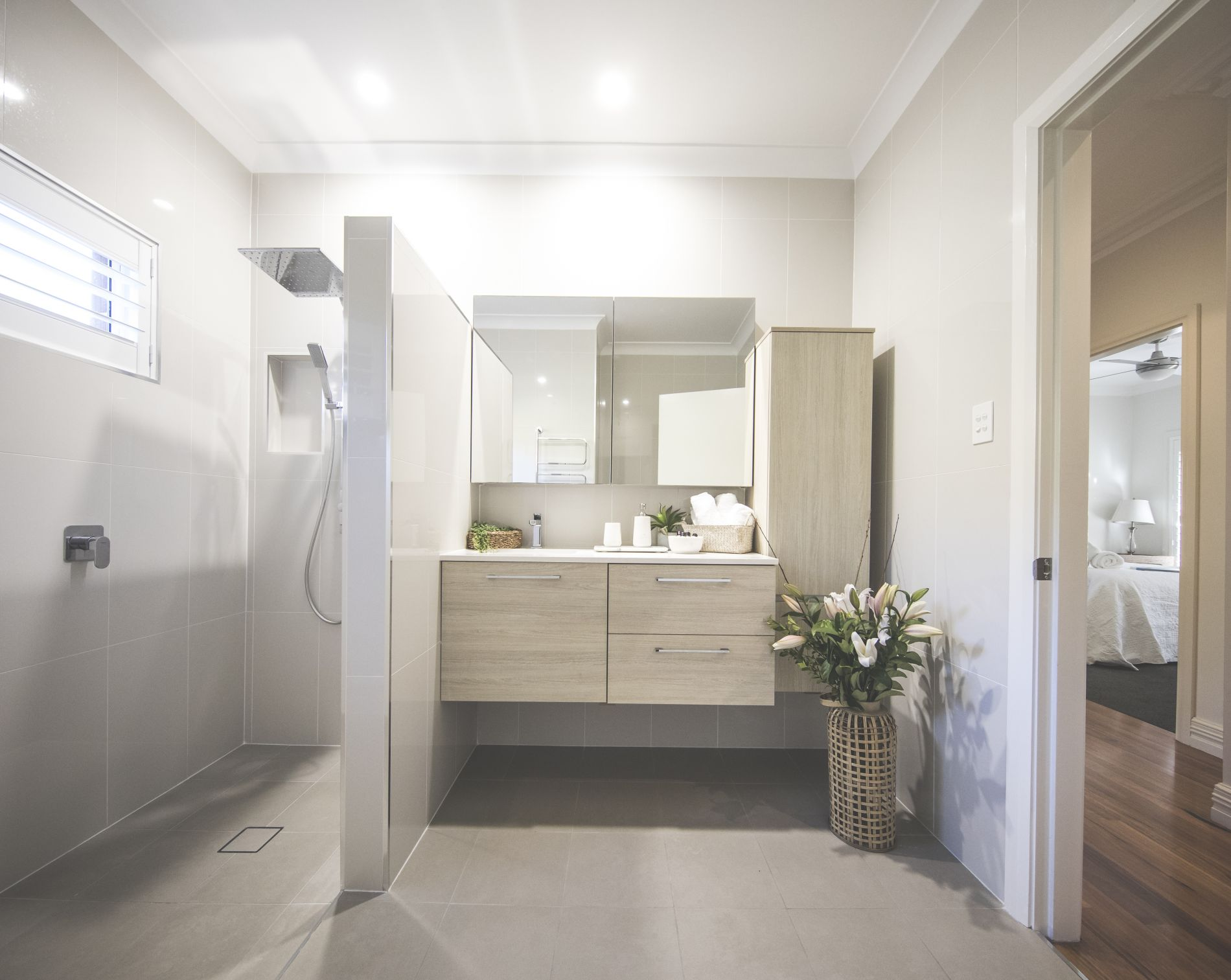 Modern sleek bathroom with shower and sink at diggers beach cottage