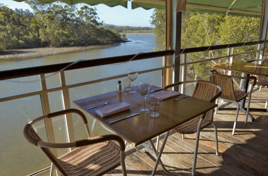 Dining for two on deck overlooking mangrove banked Coffs Creek Things to do in Coffs harbour near Diggers Beach Cottage