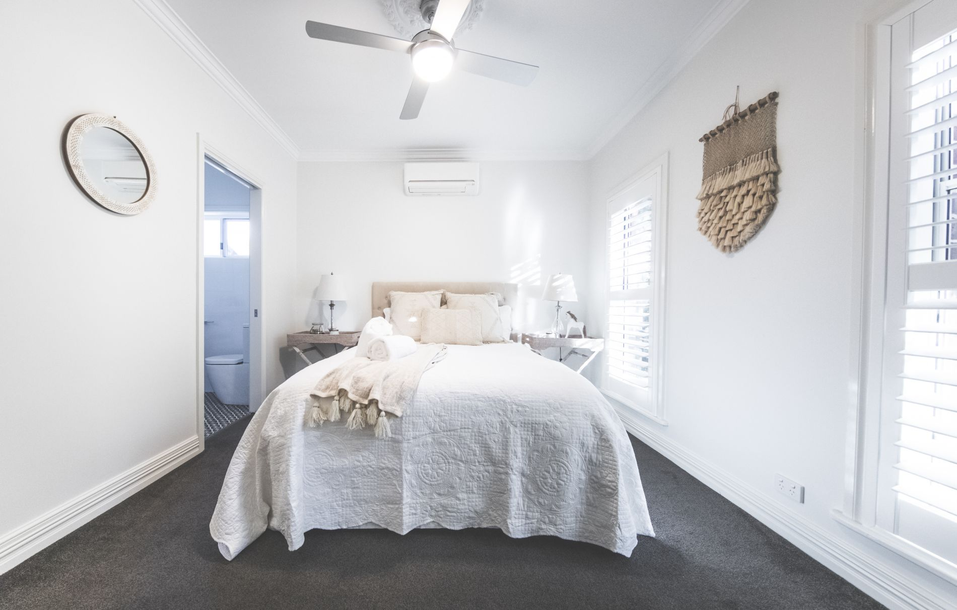 Soft white main bedroom with ensuite at diggers beach cottage holiday home
