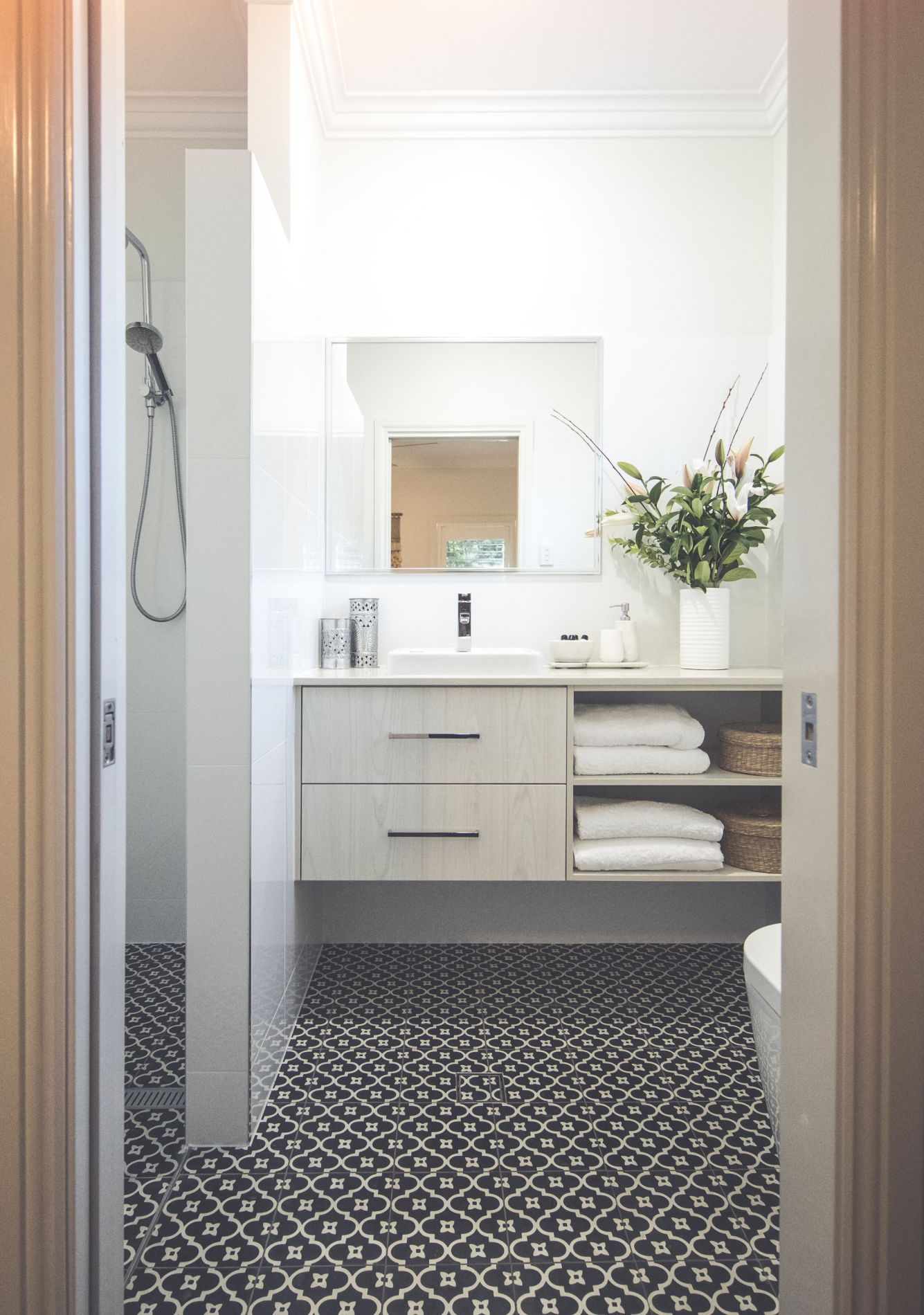Main bedroom ensuite with patterned tile floor