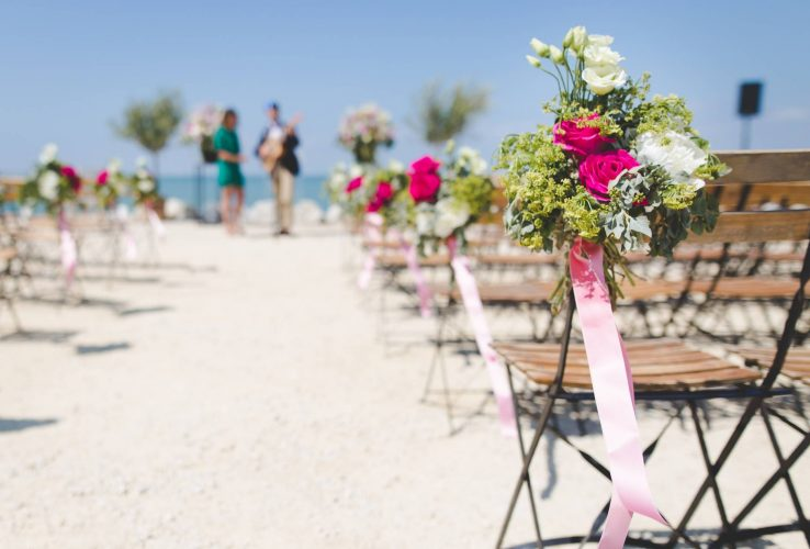 Wedding guests seating on a beach